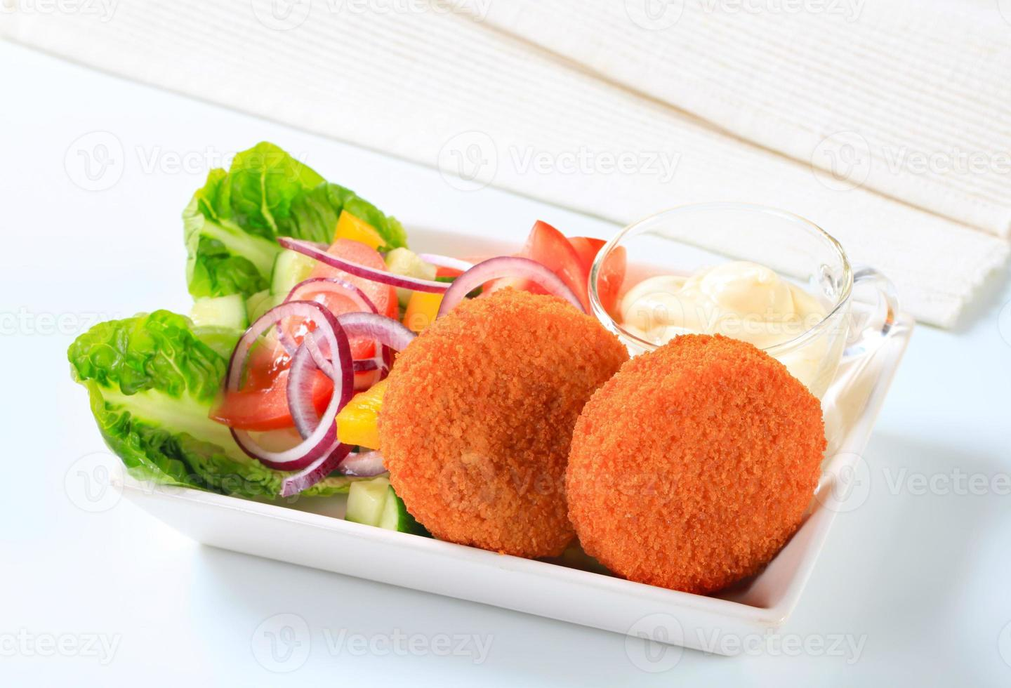 Fried cheese with vegetable salad and mayonnaise photo