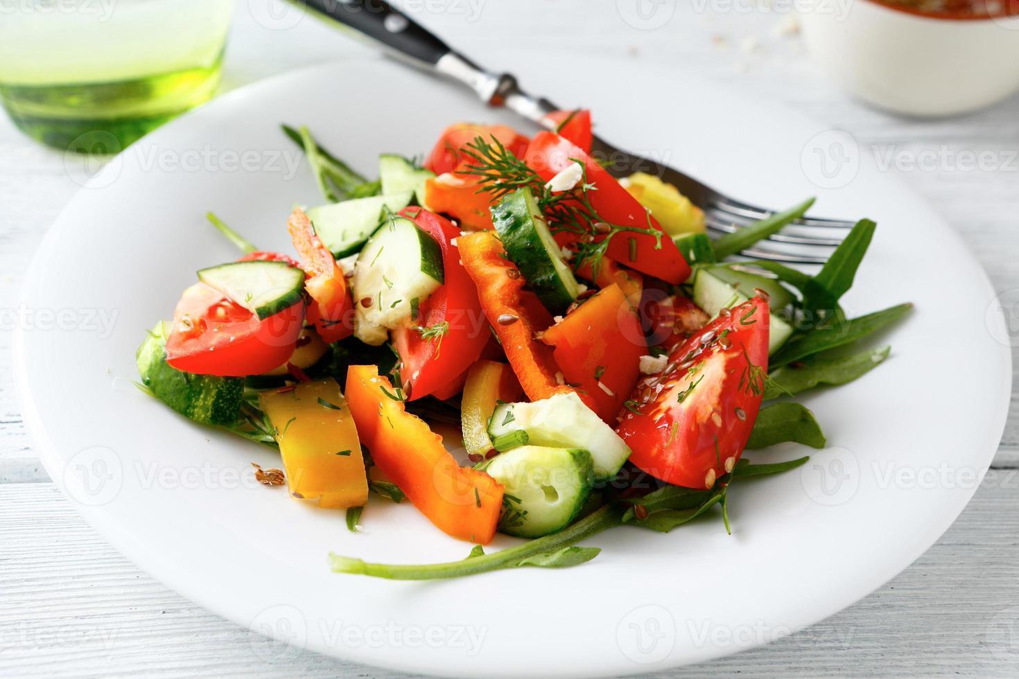 Fresh salad with tomatoes, cucumbers and arugula photo