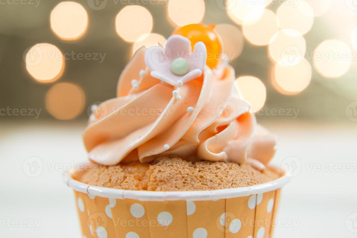 Tasty cupcake with butter cream photo