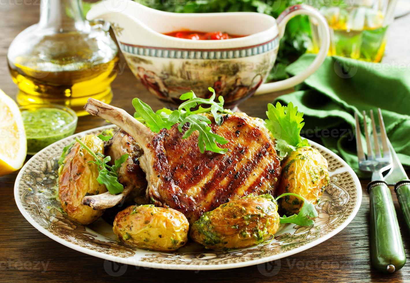 Grilled pork chop on the bone with spicy potatoes. photo
