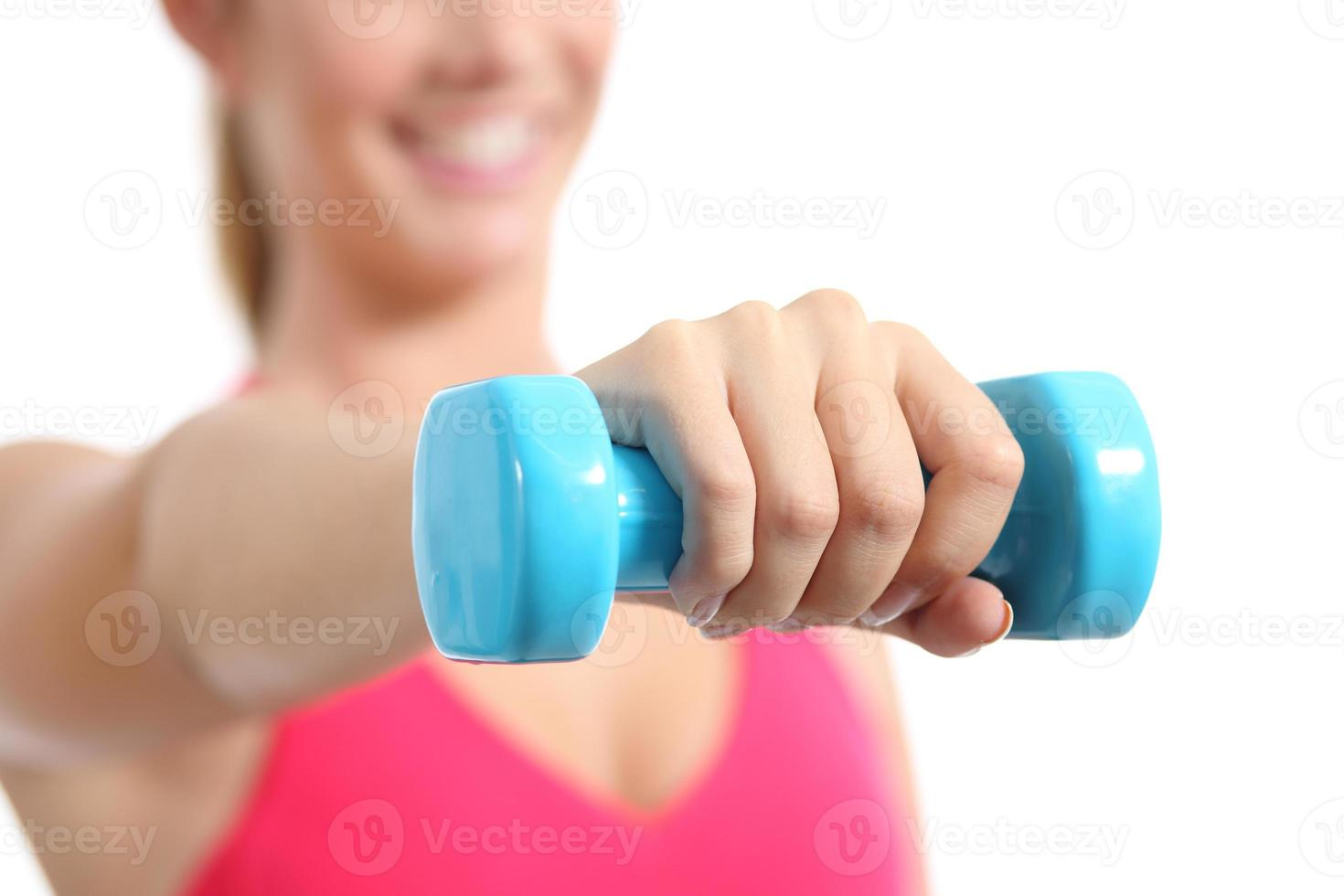 Fitness woman lifting weights exercising aerobic photo