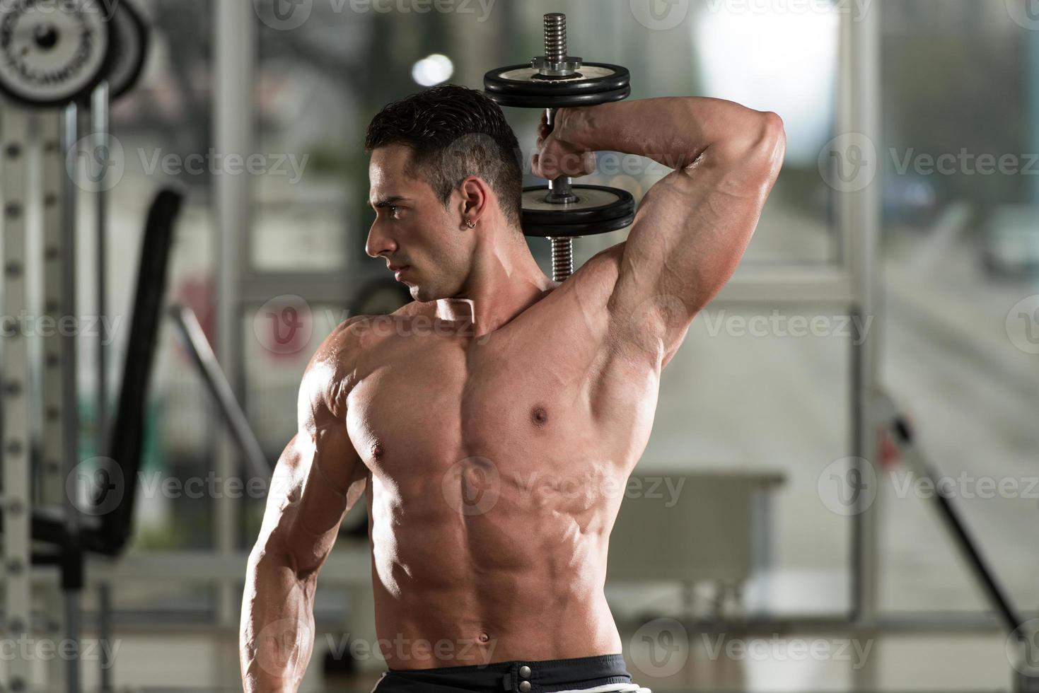 Young Man Doing Exercise For Triceps photo