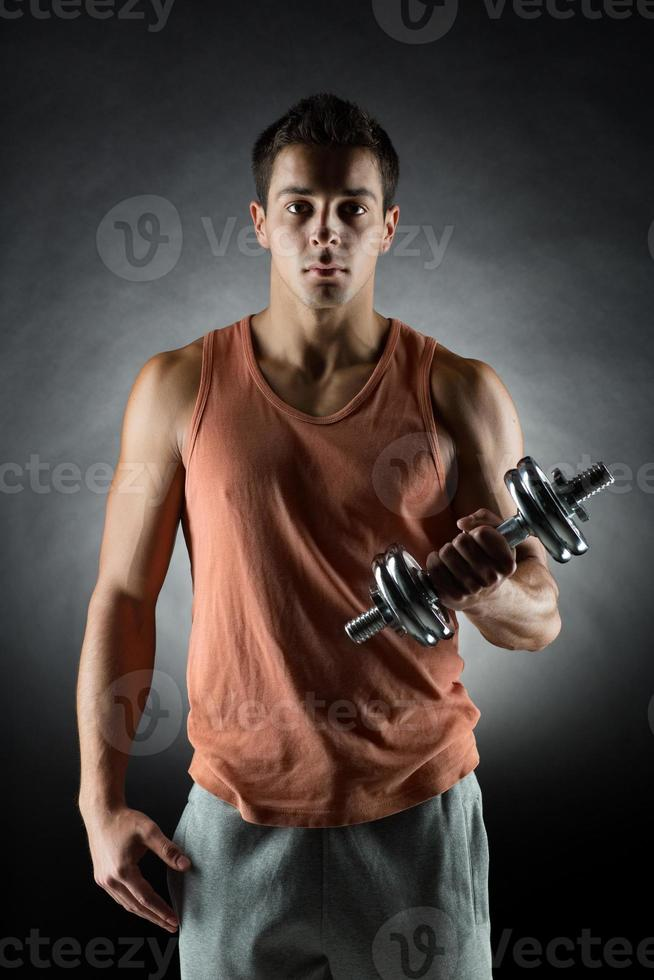 young man with dumbbell photo