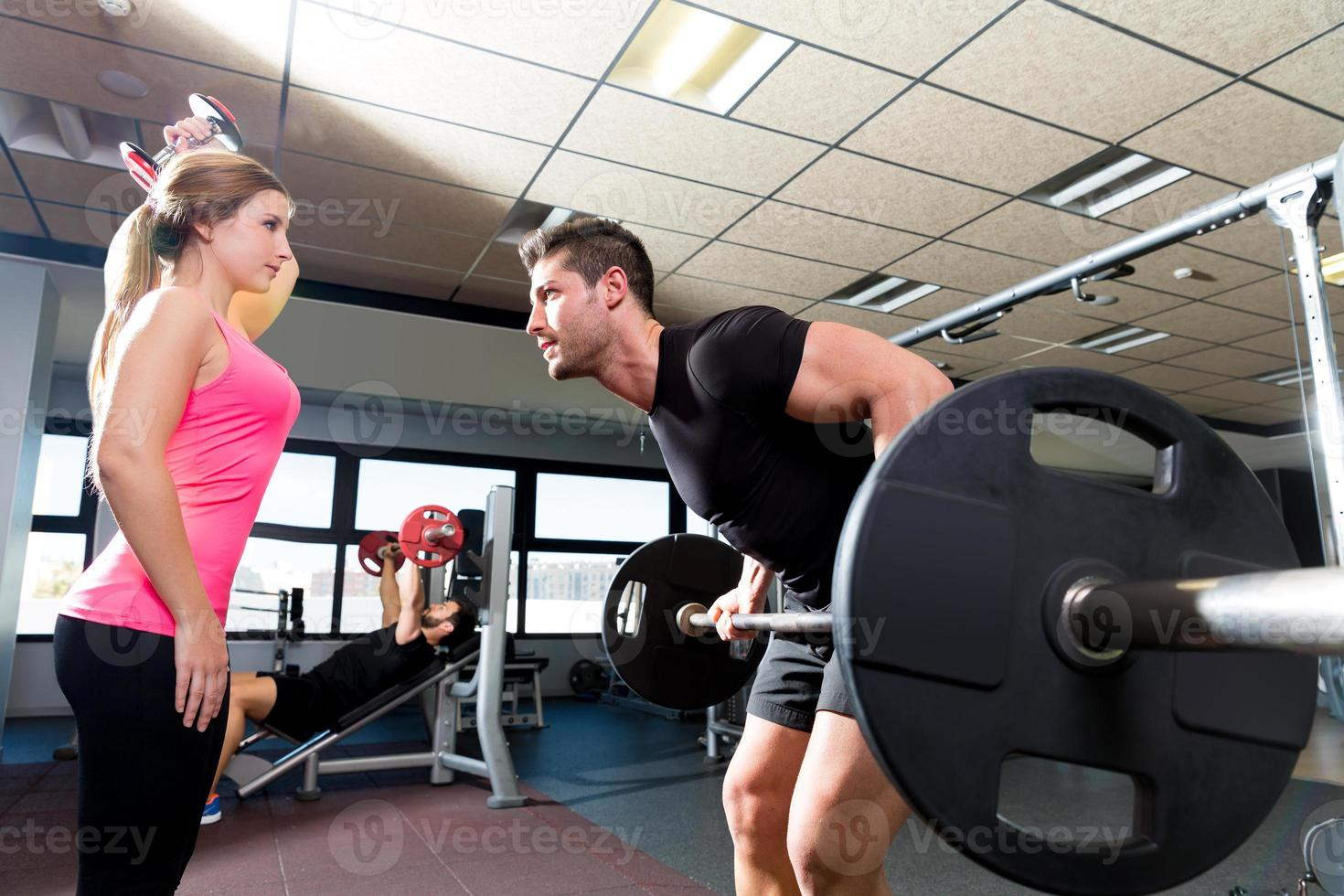 Gym weightlifting couple workout barbell dumbbell photo