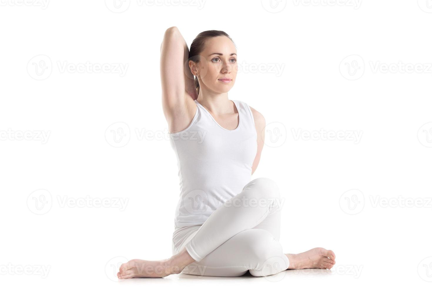 Gomukhasana yoga pose photo