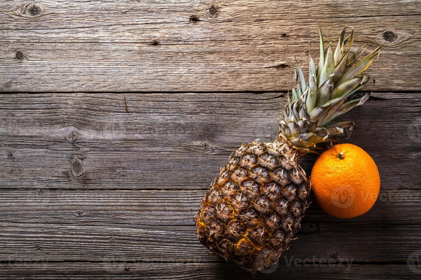 Still life of tropical fruits on wooden table photo