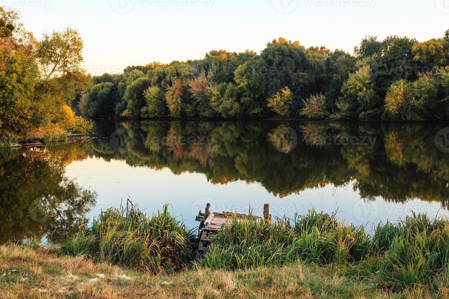 Autumn landscape at the river photo