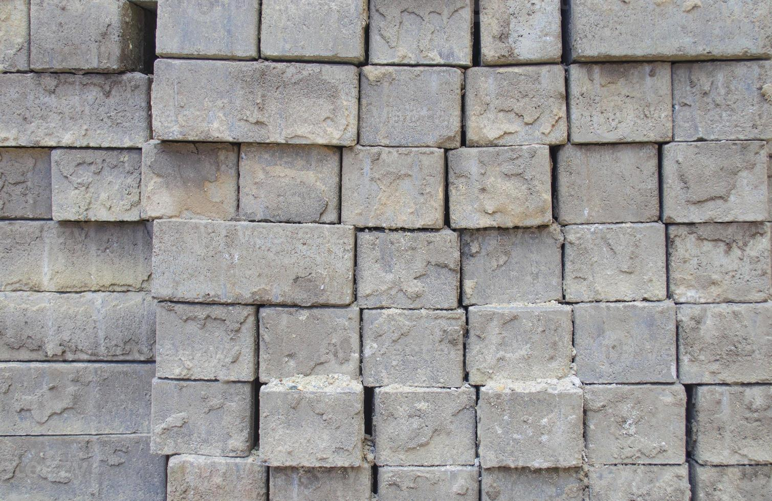 Grey bricks stacked in rows photo