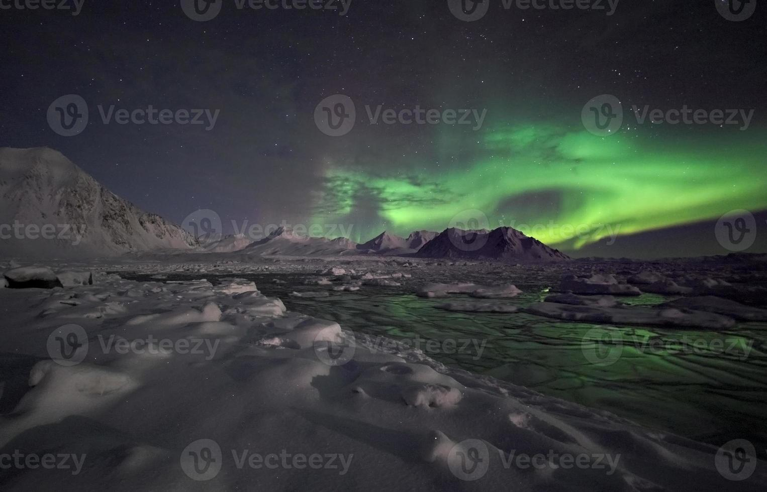 Arctic winter landscape with Northern Lights photo