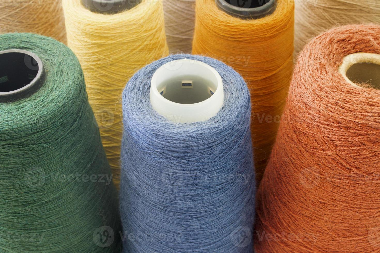multicolor background from threads and yarns photo