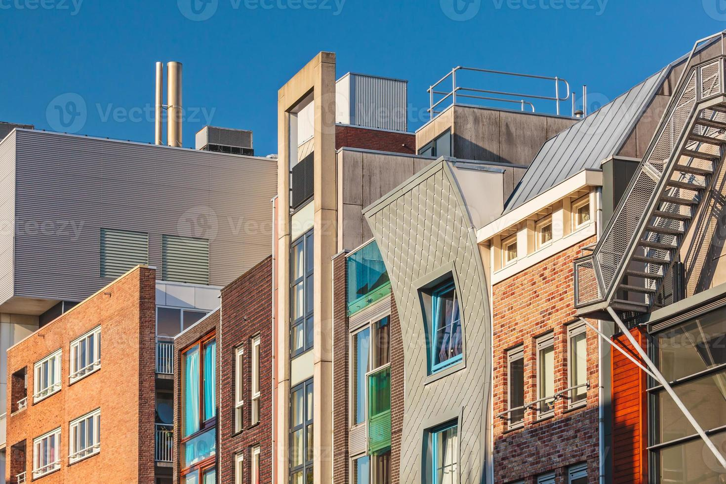 Row of Dutch contemporary canal houses in Amsterdam photo