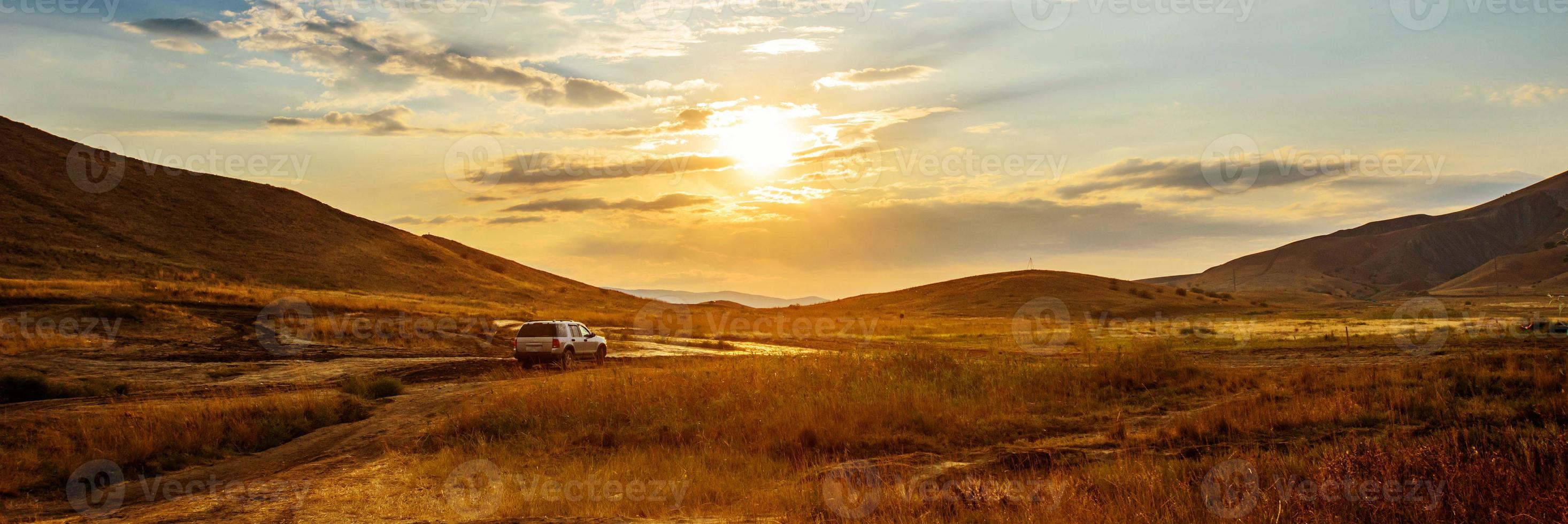 car at sunset photo