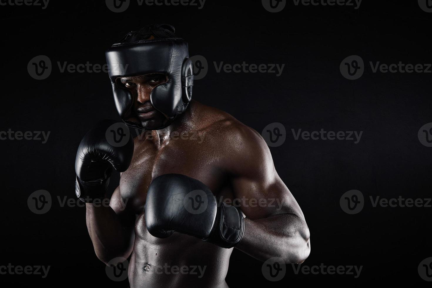 Young male boxer in a fighting stance photo