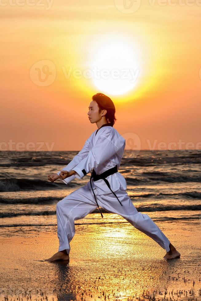 Martial arts training on beach photo