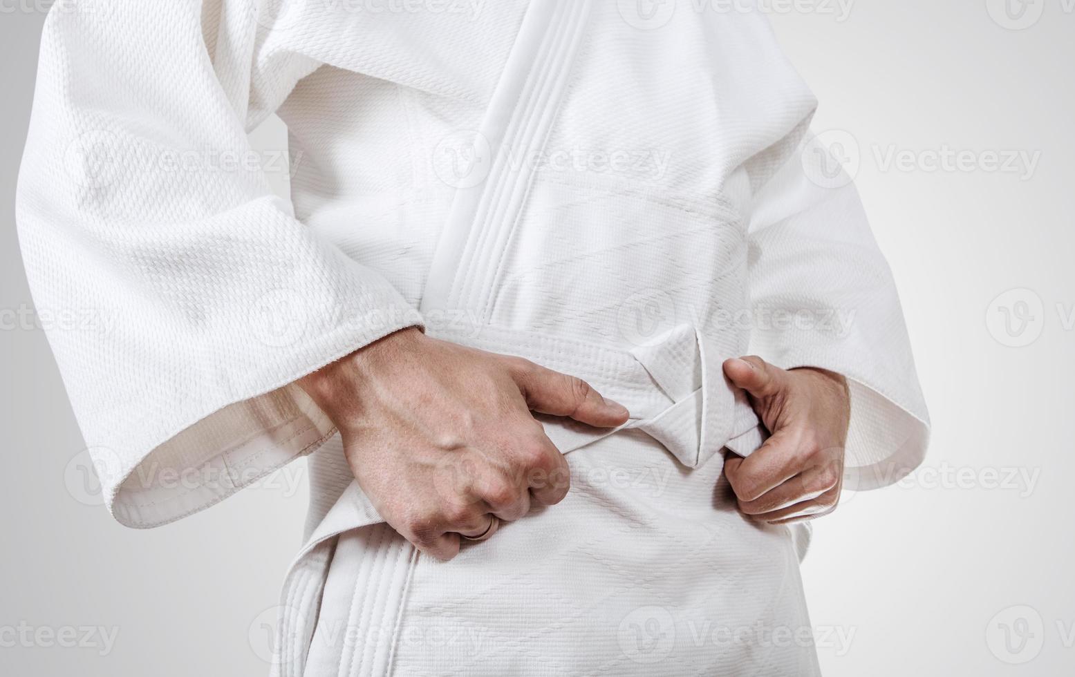 Tying kimono belt close up image photo