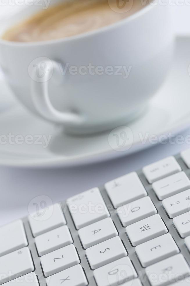 Cup of coffee with a keyboard photo