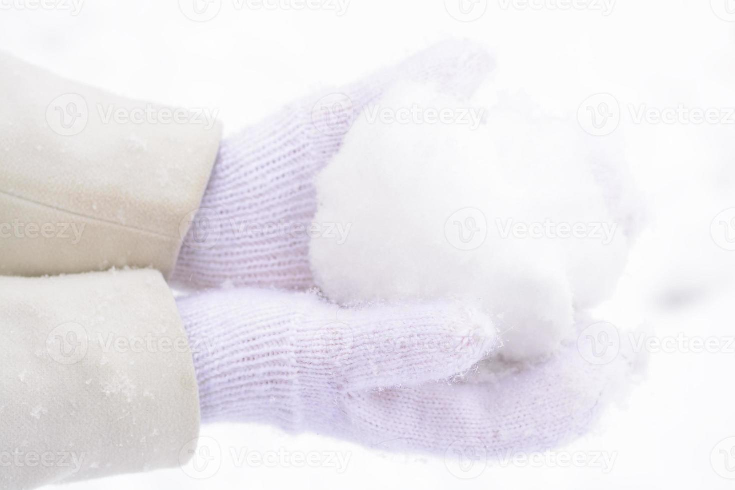 Hand in mittens and snow photo