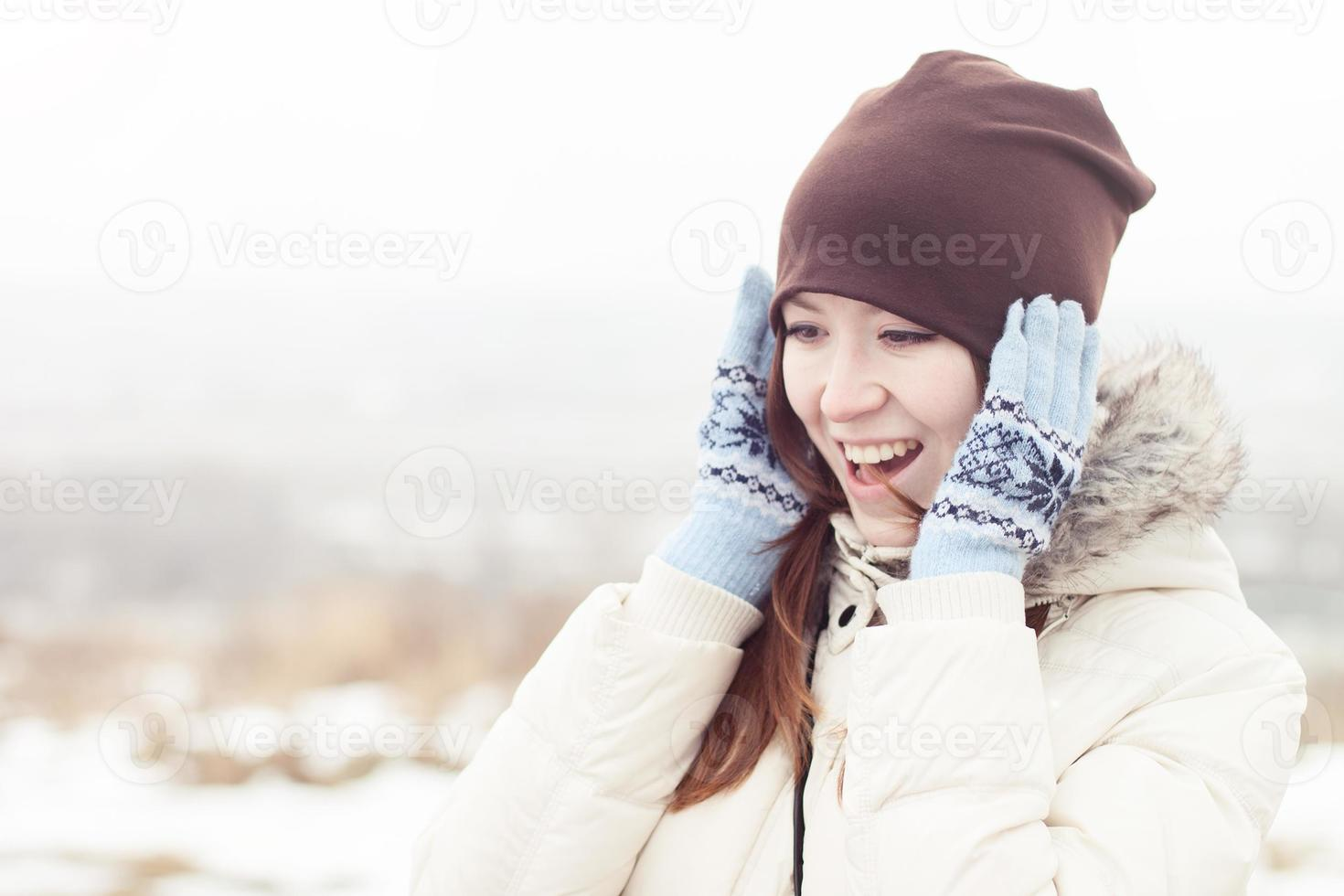 Happy girl in winter forest photo