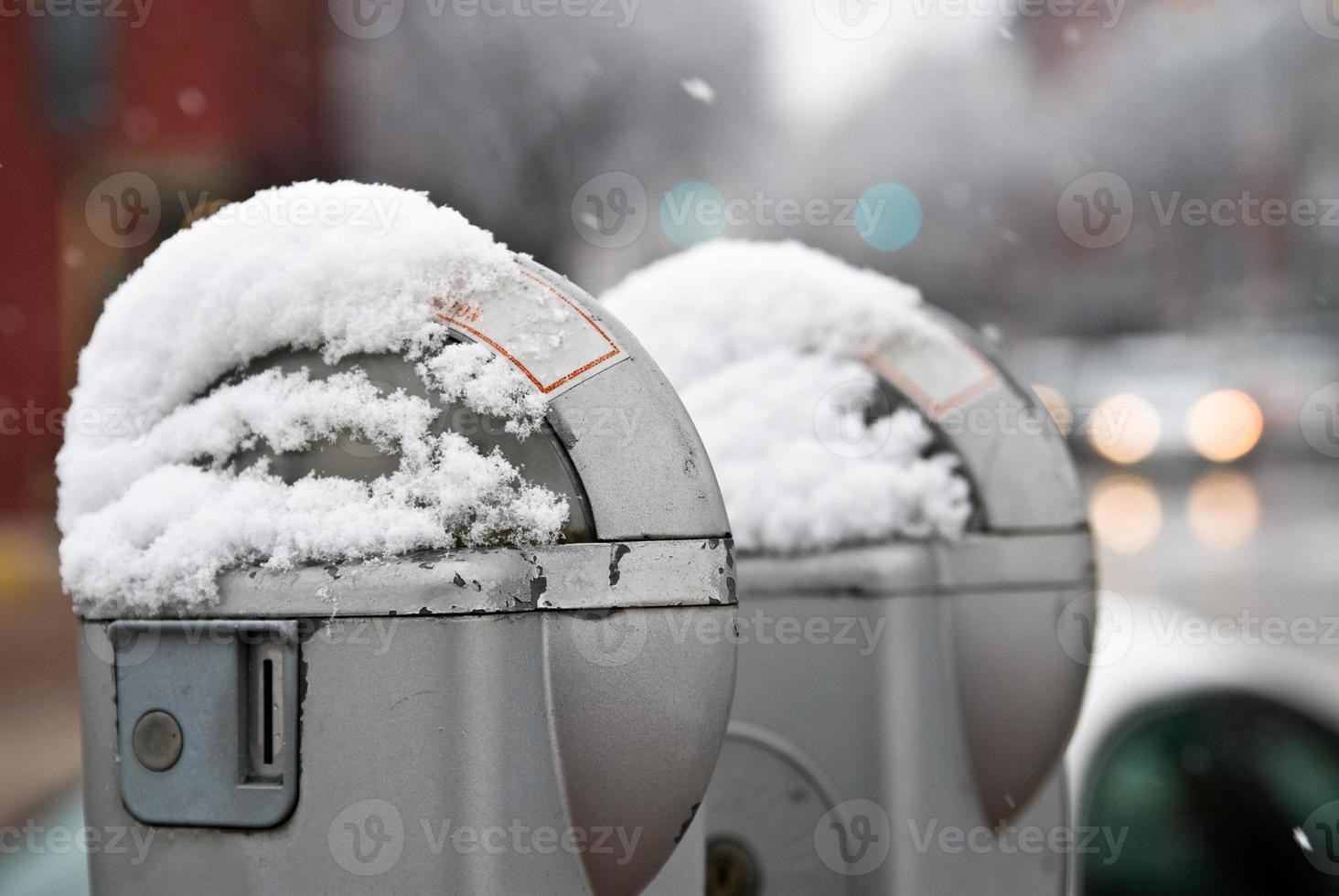 Parkng meters in winter photo