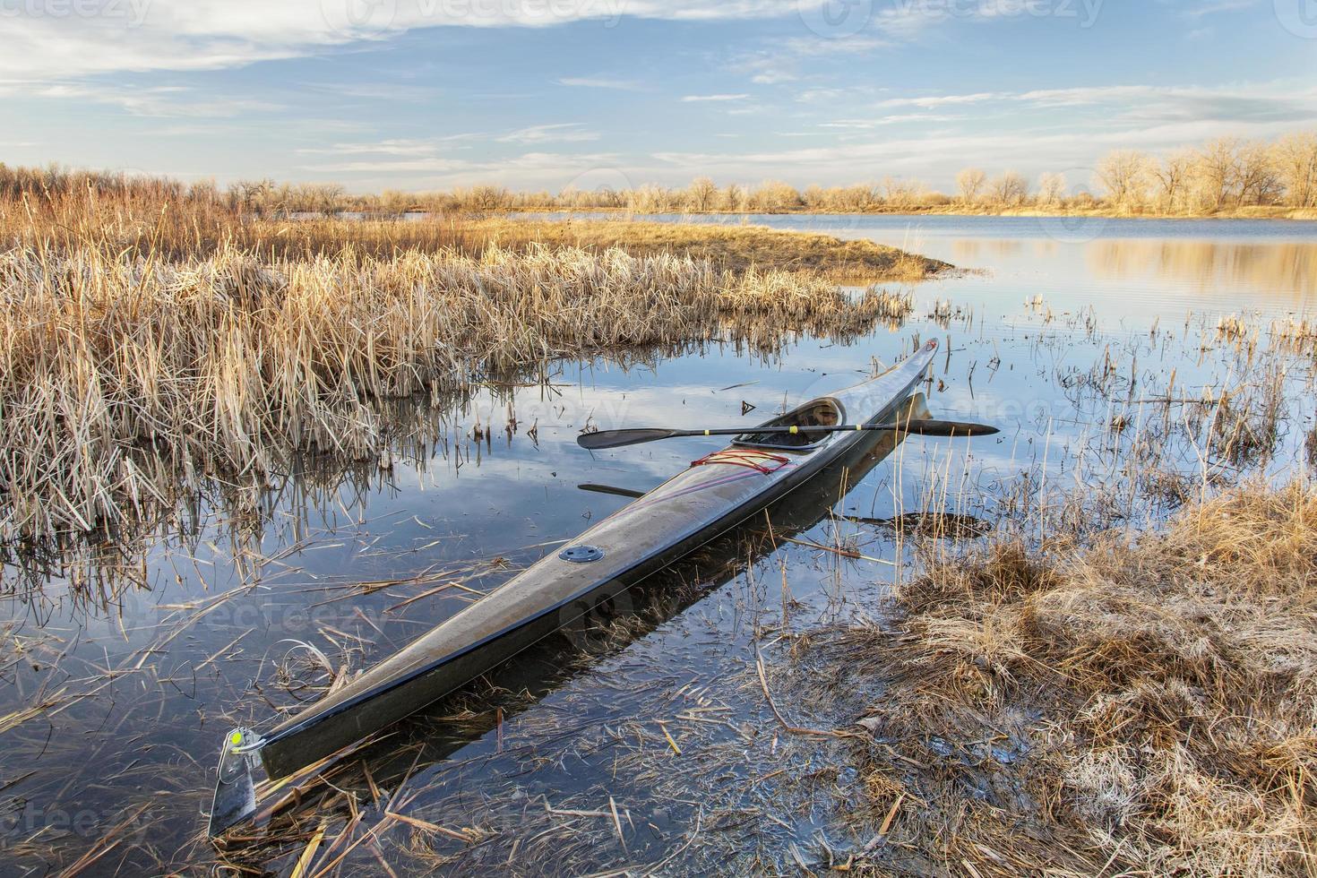 racing sea kayak ready for paddling photo