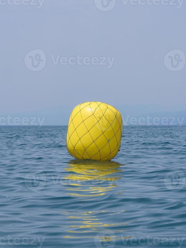 Yellow buoy for regatta photo