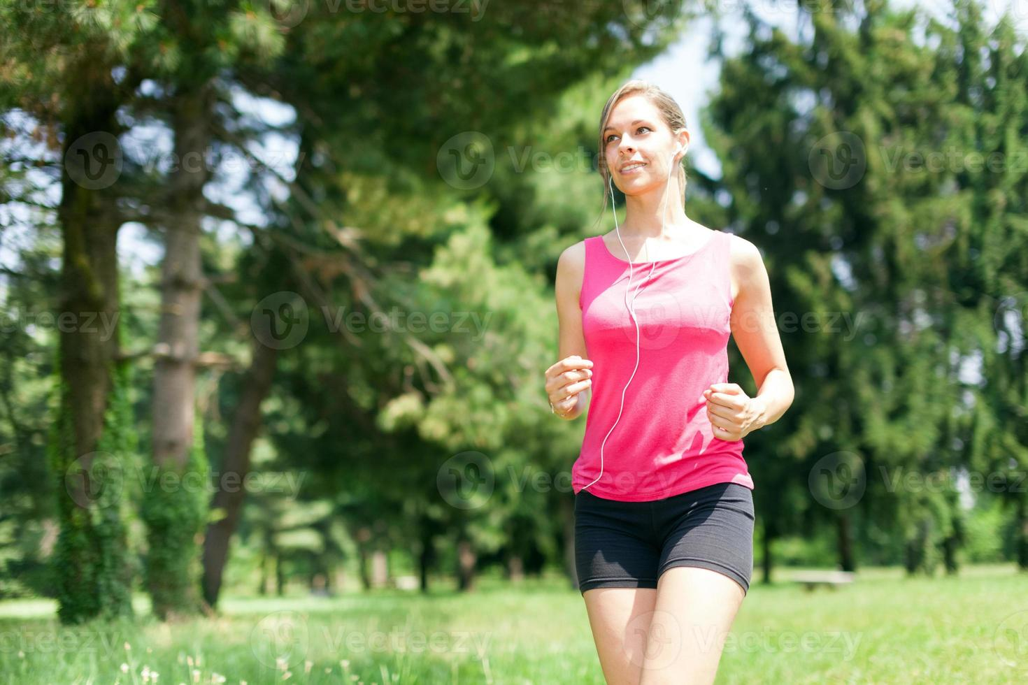 Woman running outdoors photo
