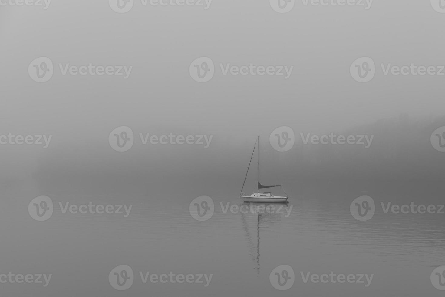 Boat on foggy lake photo