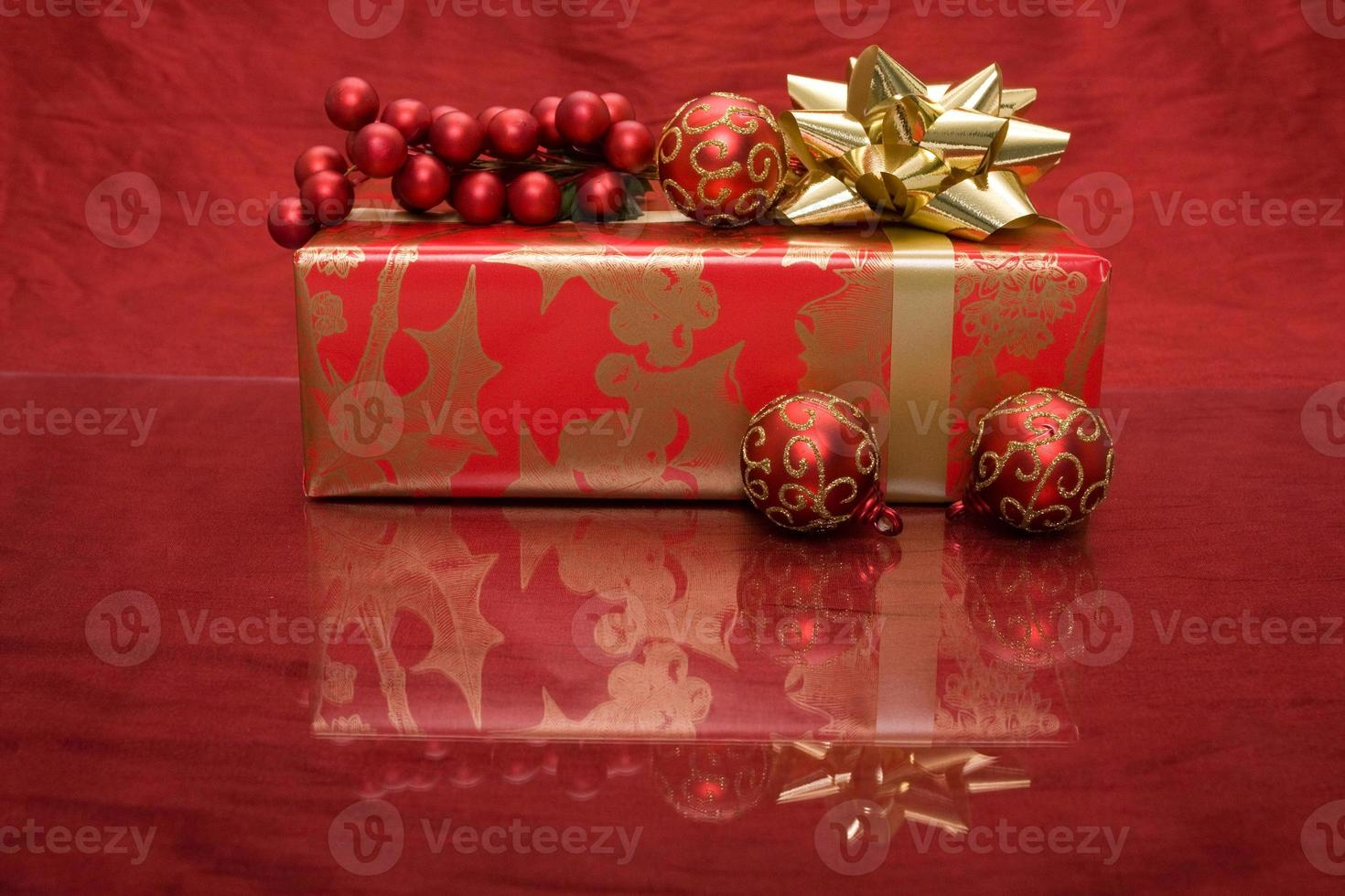 Christmas present with ornament and holly photo