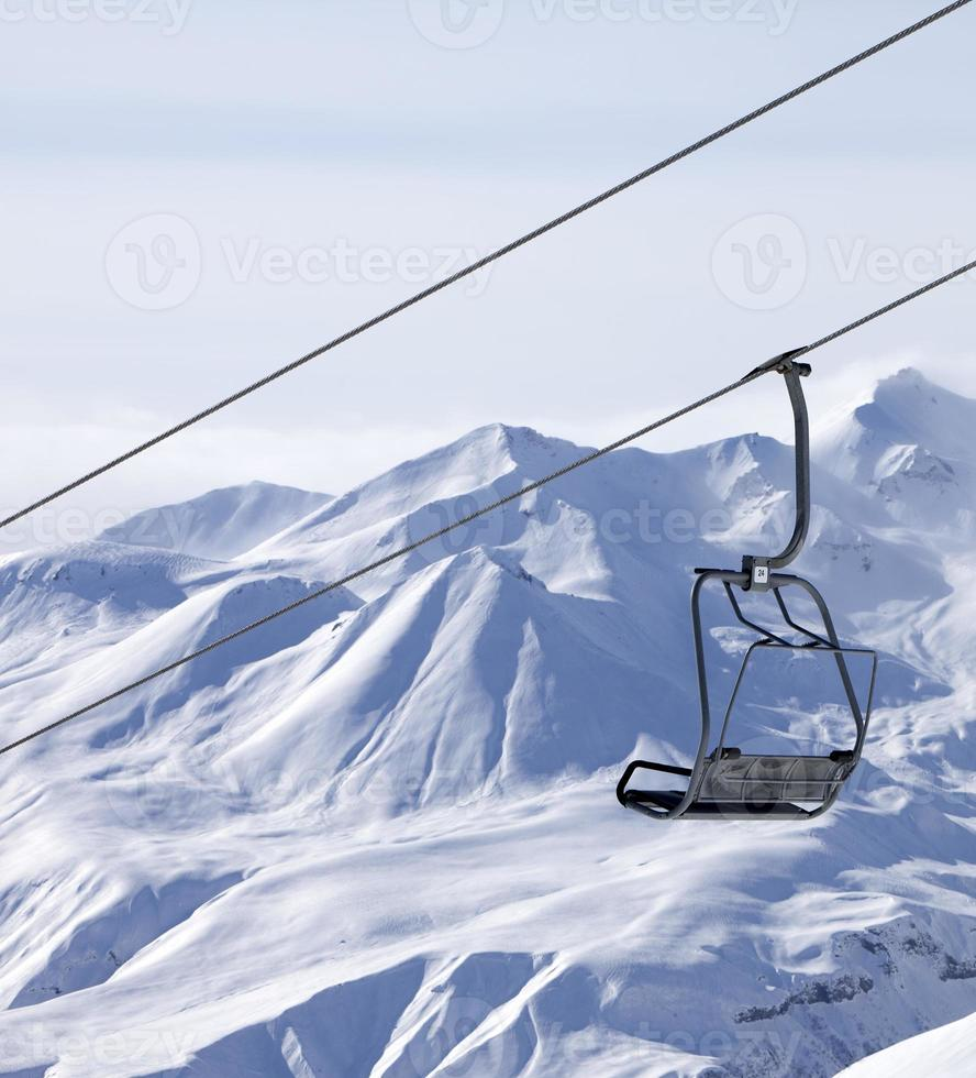 Chair lifts and off piste slope in fog photo