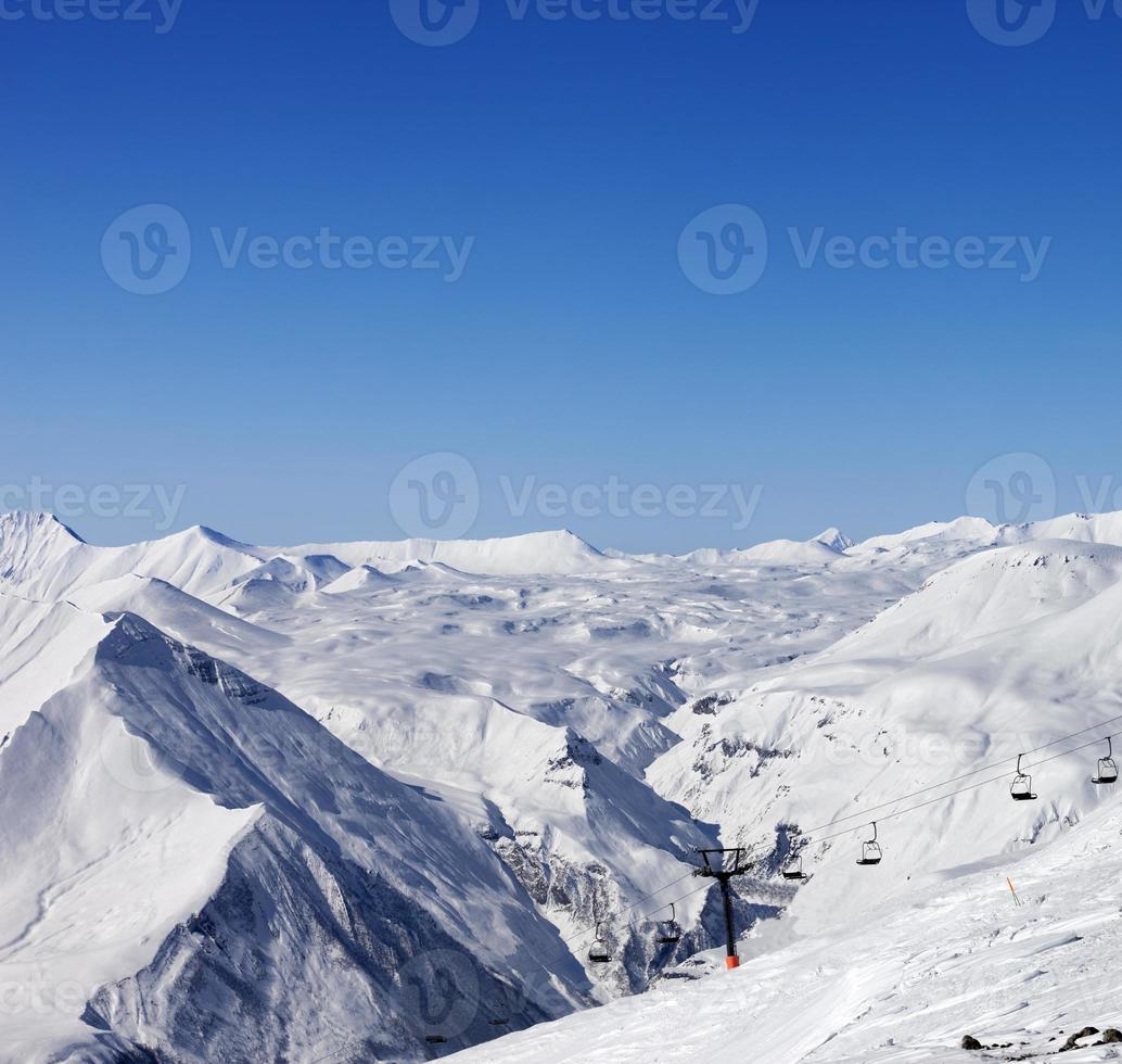 Ski resort at sun winter day photo