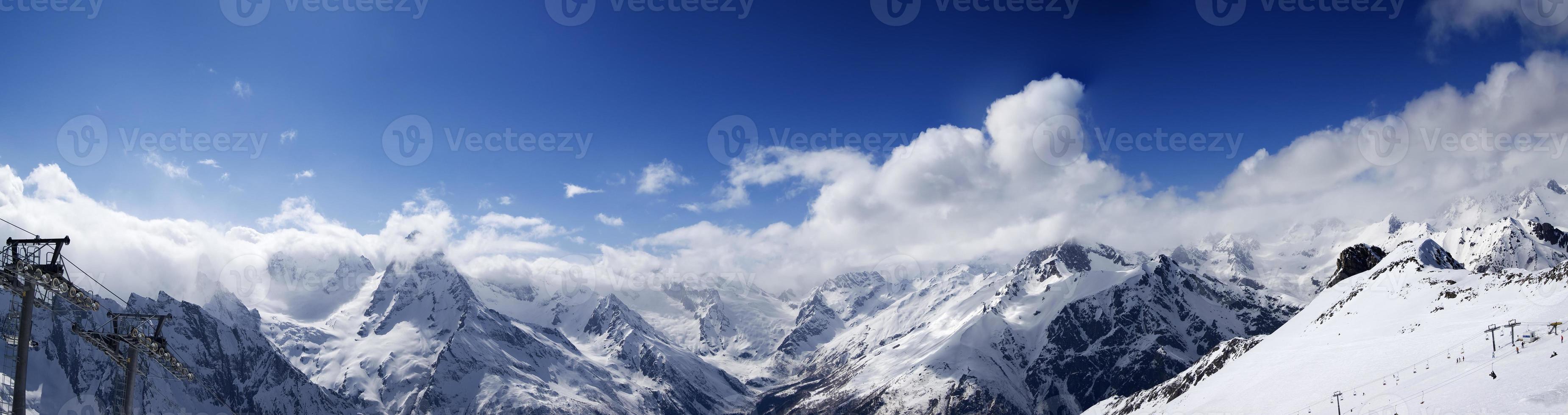 Panoramic view on ski slope in nice sun day photo