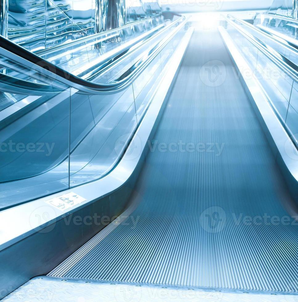 Escalator in airport photo