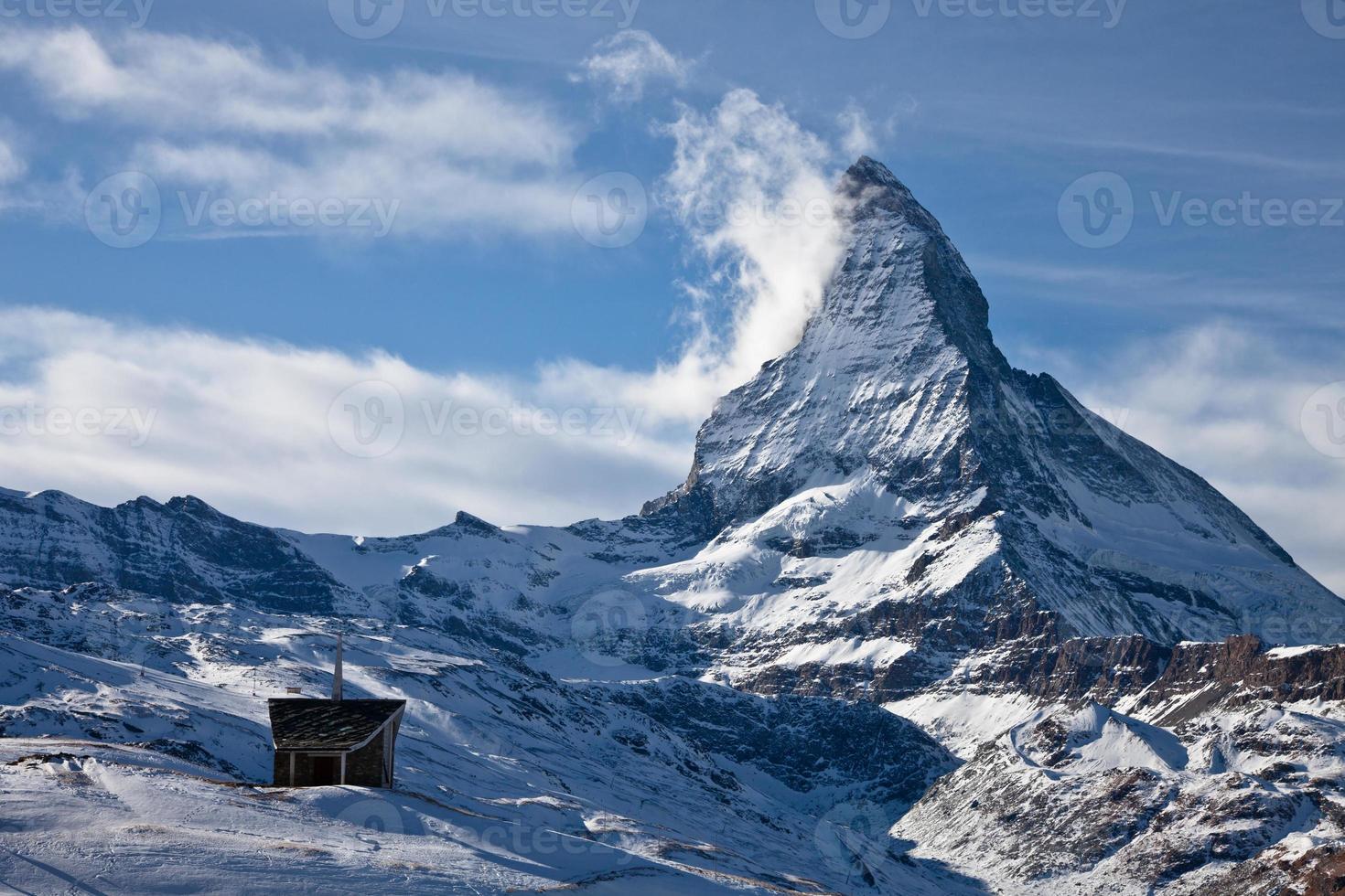 Riffelberg Chapel in the snow below the Matterhorn photo