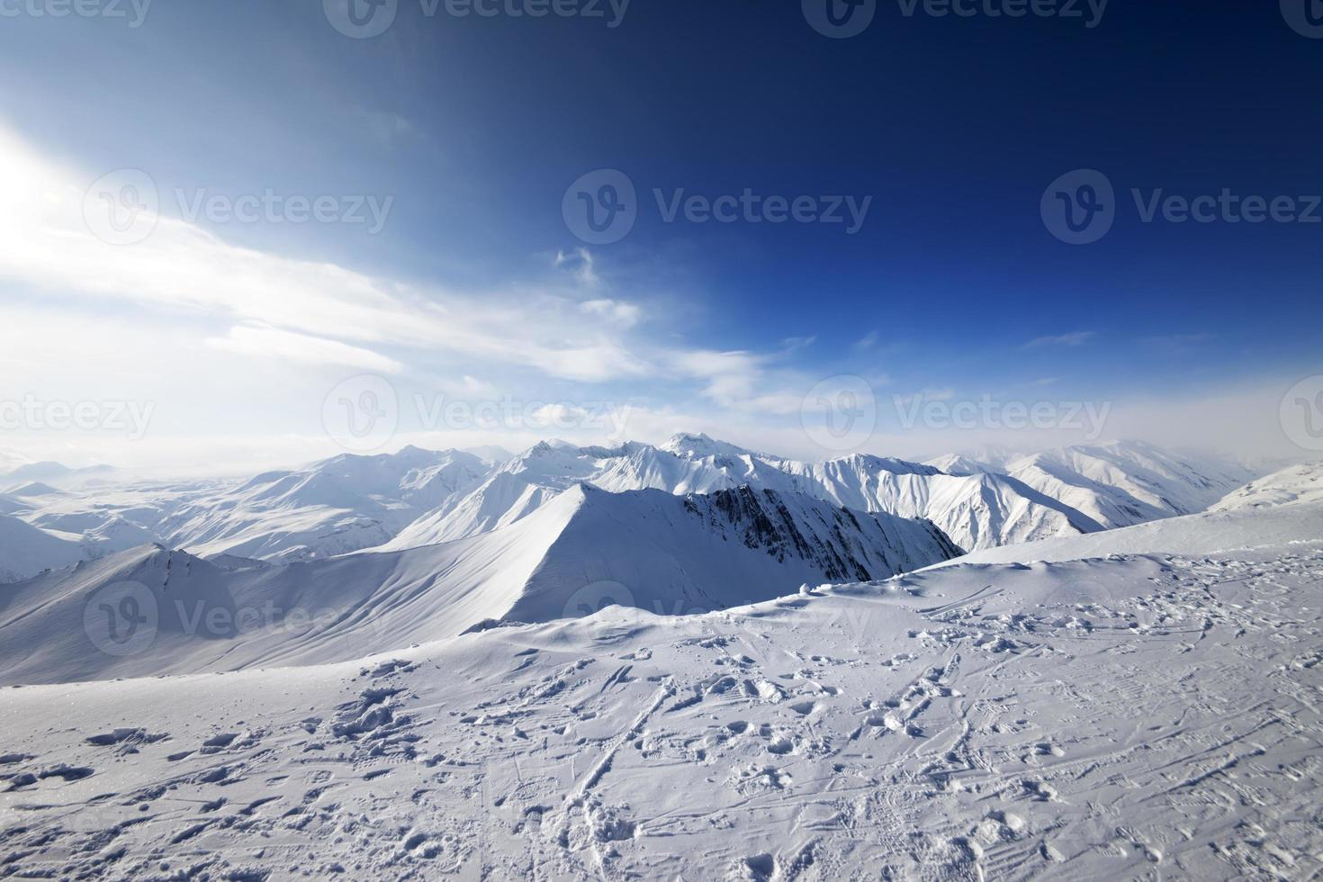 Snowy mountains at nice day photo