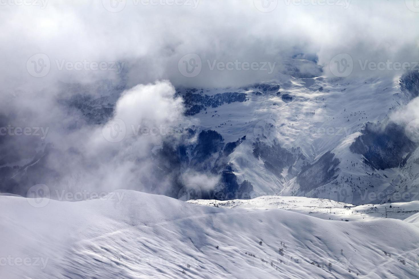 Off-piste slope in sunlight clouds photo