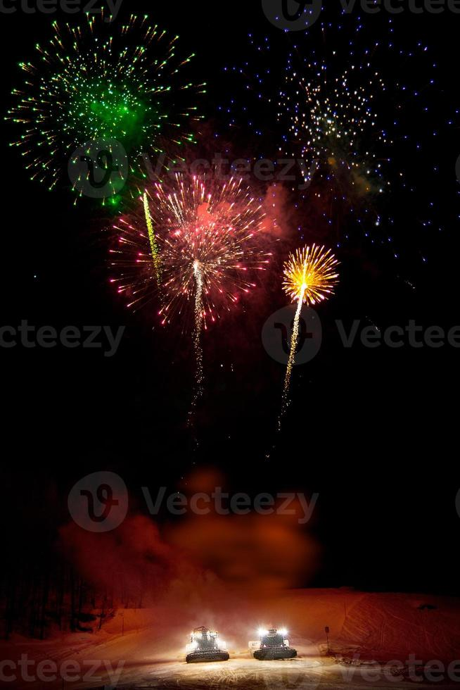 Fireworks from snowcats in Saas-Fee photo