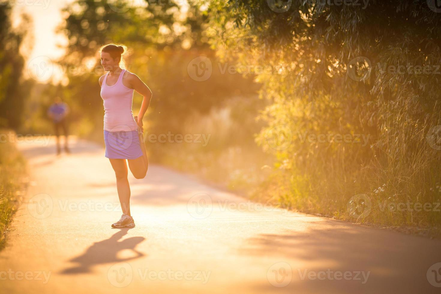 Young woman running outdoors photo