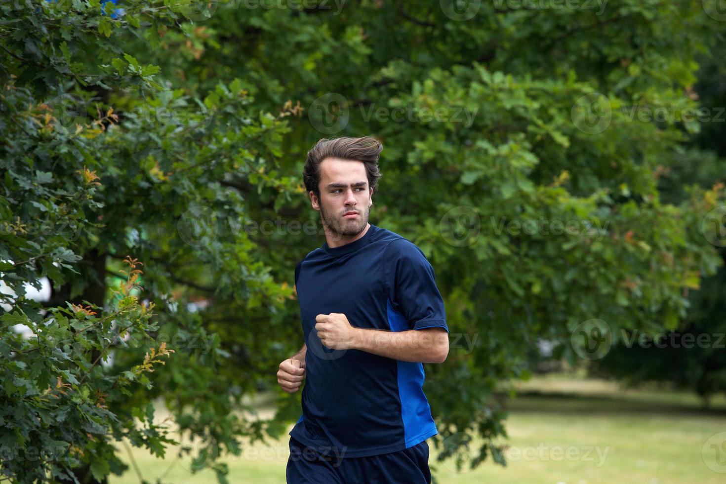 Close up young man running photo