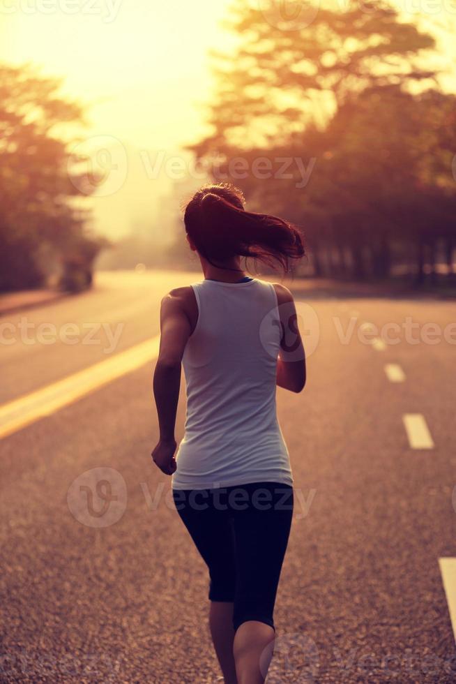 Runner athlete running at road photo