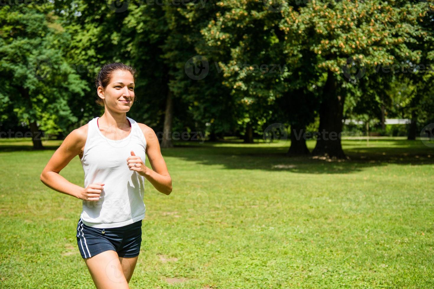 Jogging - woman running in nature photo