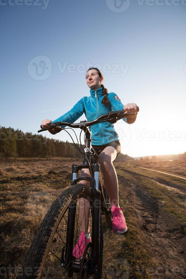 Close up of woman riding mountain bike photo