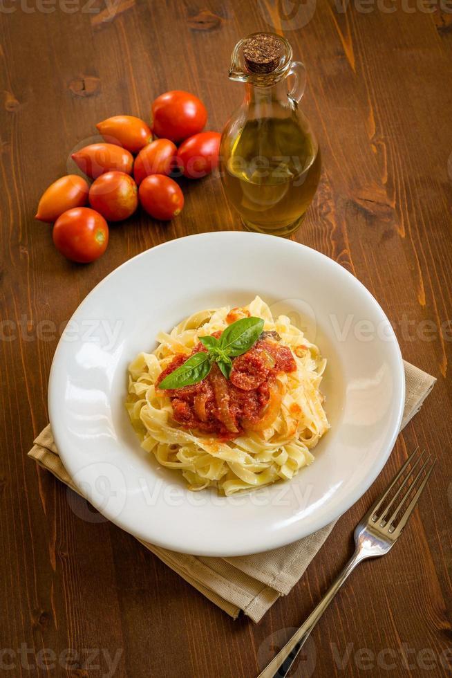 Tagliatelle with tomato sauce photo
