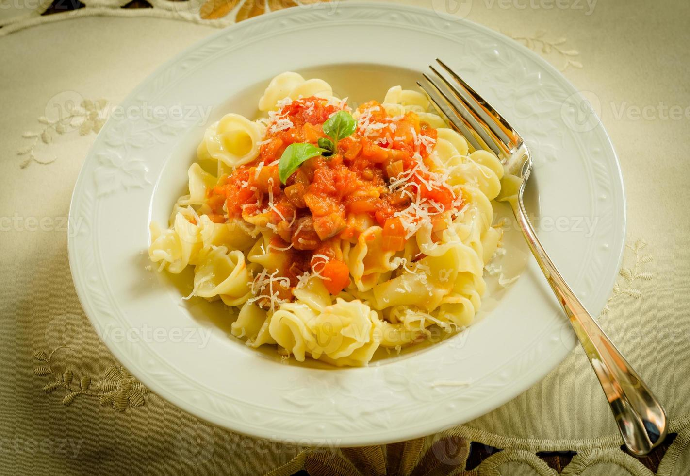 Gigli with tomato sauce and parmigiano photo