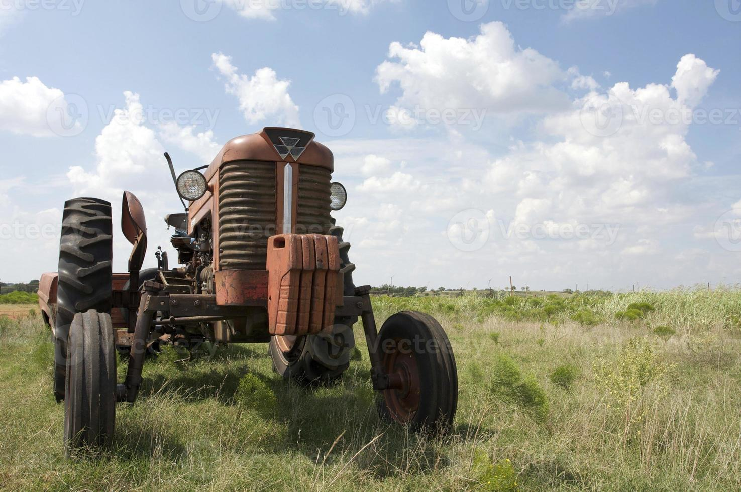Circa 1960s Vintage Tractor in a Field with logos removed photo