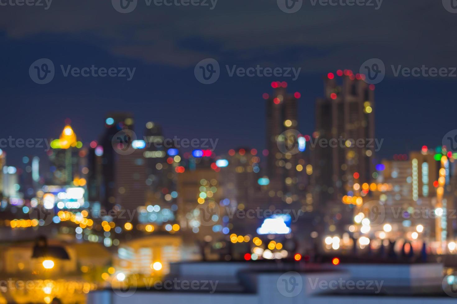Blur bokeh lights of city during busy hours photo