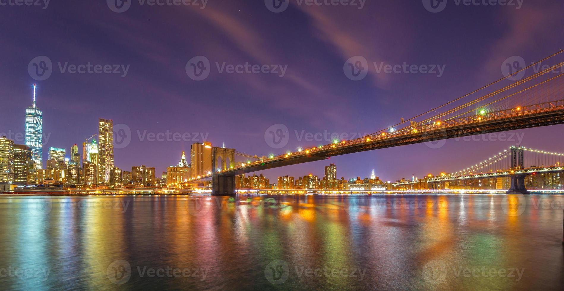 Brooklyn Bridge and downtown Manhattan skyline at nigh photo