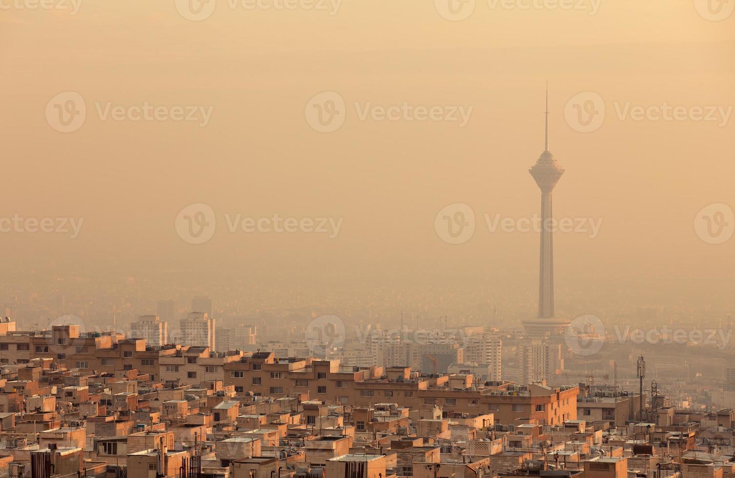 Sunset Light on Skyline of Air Polluted Tehran photo