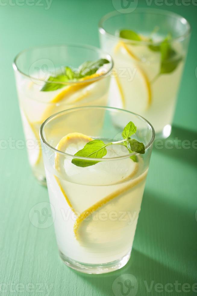 fresh lemonade with mint in glasses photo