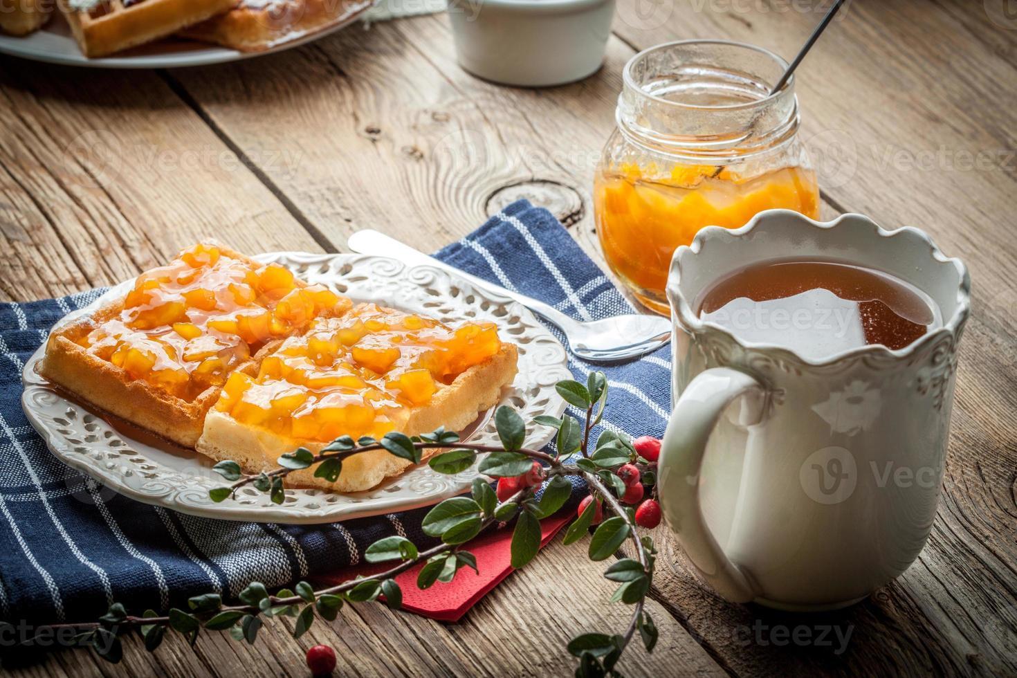 Waffles with peach jam. photo