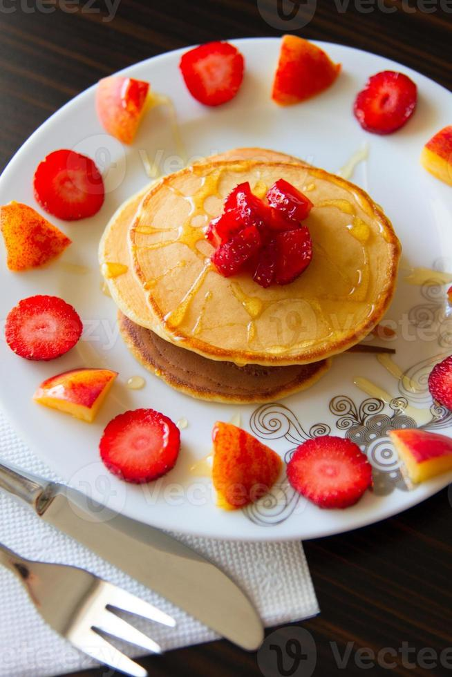 Pancakes with fruits and honey photo